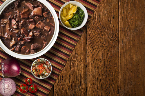 Cuadros en Lienzo Brazilian Feijoada Food. Top view with copy space.