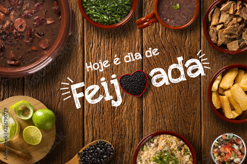 "Brazilian Feijoada Food. Written ""Today is Feijoada's Day"" in Portuguese. Top view"