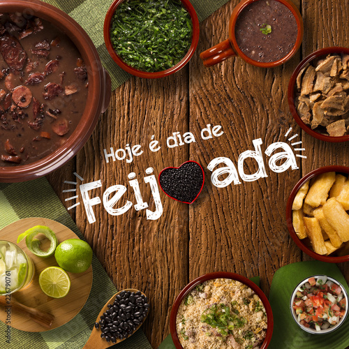 "Brazilian Feijoada Food. Written ""Today is Feijoada's Day"" in Portuguese. Top view."