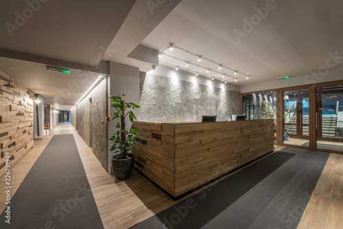 Fototapeta Reception desk and view on hallway in modern hotel