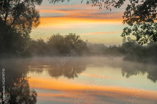 Sunrise mist over river