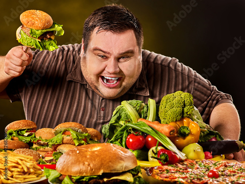 Leinwand Poster Diet fat man who makes choice between healthy and unhealthy food