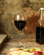 glass of red wine on a wooden table. top view. food background