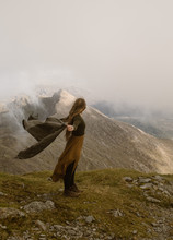 Woman On Top Of Mountain In The Clouds In Wales