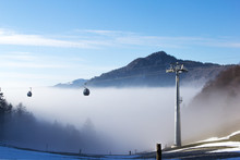 Cable Car In The Foggy Winter Morning Over The Alps Weissenstein Mountain,  Solothurn, Switzerland