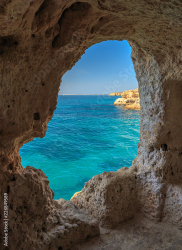 Obraz The cave view at Aboneca rock in Algar Seco near Carvoeira - fototapety do salonu