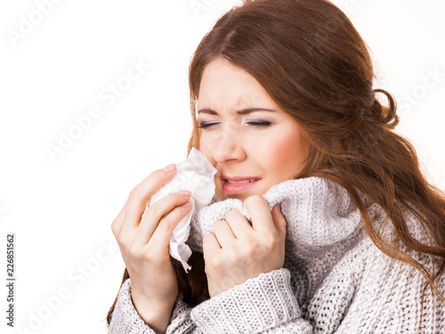 Sick freezing woman sneezing in tissue Tablou Canvas