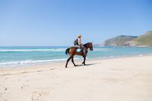 Man Riding A Horse At The Beac...