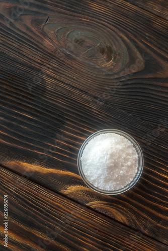 Fotobehang Kruiderij Bowl of salt on the wooden background