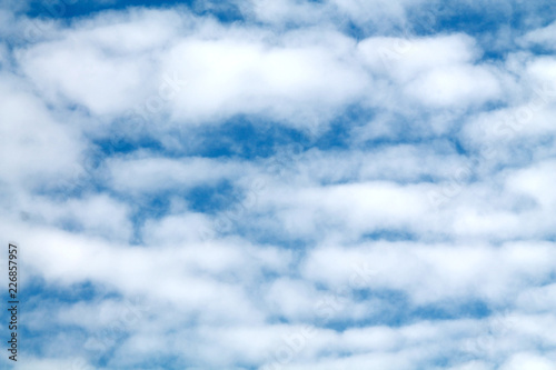 Abstract background with blue sky and small white clouds Wallpaper Mural