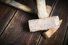 Close Up Of Tree Old Used Hammer On A Rustic Wooden Background. Selective Focus