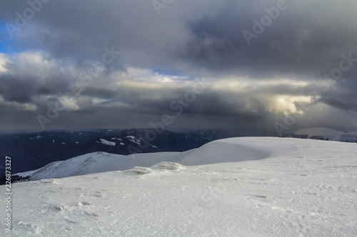 Foto op Plexiglas Grijs Winter mountain view in Carpathian mountains with dramatic clouds