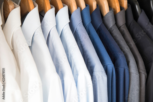 Fotografia, Obraz  Office Business shirts hanging in a closet ordered by colour