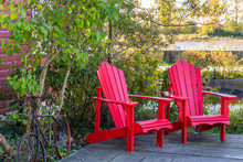 Two Red Adirondack Chairs