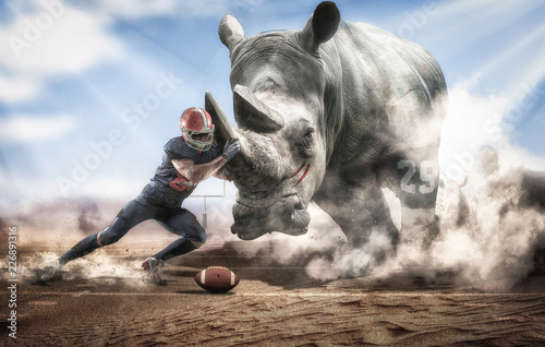 Photo sur Toile Rhino Brave American football player facing a big rhino
