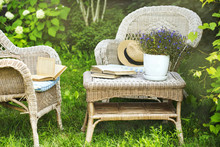 Wicker Table, Chairs And Books...