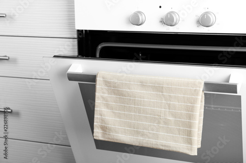 Open modern electric oven in kitchen, closeup view