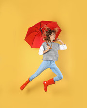 Woman With Red Umbrella Near Color Wall
