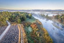 Morning Fog Over A River In Colorado