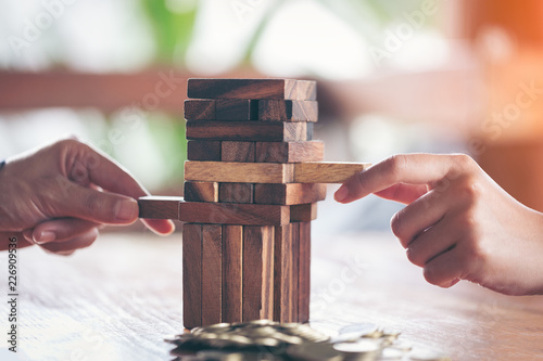 Fotografie, Obraz  Businessman hand stop dominoes continuous toppled or risk with copyspace