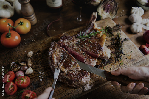 Tomahawk steak on a wooden board food photography recipe idea