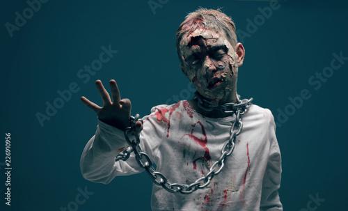 Photo  dead boy zombie. horror halloween concept