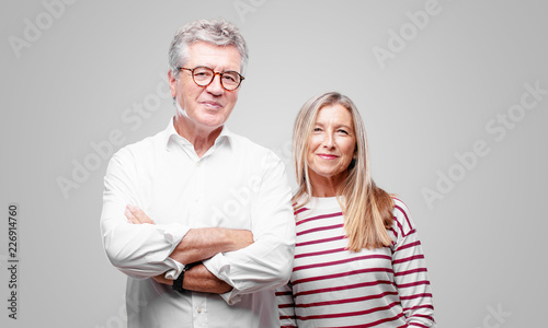 Fototapeta  senior cool husband and wife with a satisfied and happy look on her face, smiling sincerely an affectionate smile