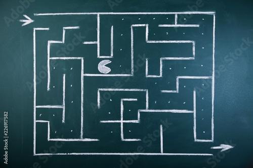 Valokuvatapetti Maze drawn on a blackboard with a pacman figure inside of it