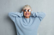 canvas print picture - senior cool woman against grunge cement wall.