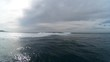 Pan right, ocean waves on overcast day