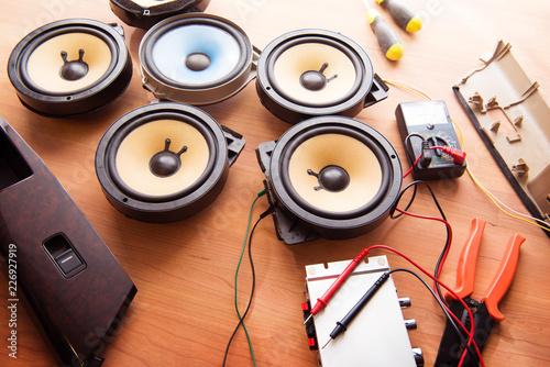 Tweaking audio. Car audio speakers on a work table. Canvas Print