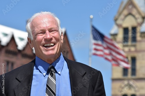 Valokuva Adult Senior Male Politician Smiling Wearing Suit