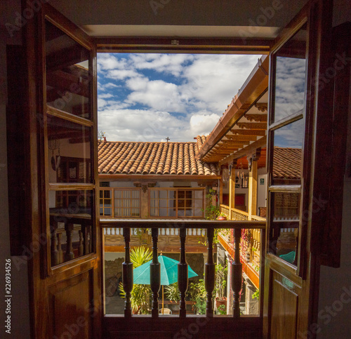 Looking off the balcony at a Hotel Courtyard in Cusco, Peru Wallpaper Mural