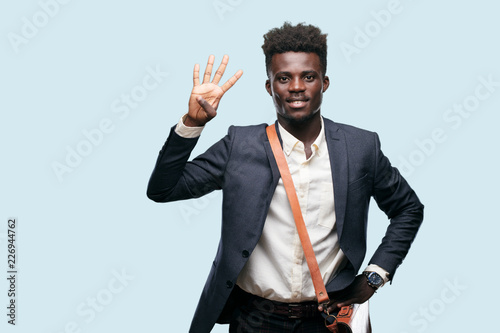 young black businessman smiling and looking satisfied and happy, counting number four with fingers Tapéta, Fotótapéta