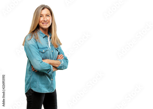 Fotografie, Obraz  senior beautiful woman standing sideways, with a proud, satisfied and happy look on face, smiling with arms crossed