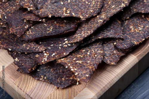 Fotobehang Steakhouse dried beef slices in spices with sesame seeds
