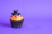 Variety Of Halloween Cupcakes On Background.
