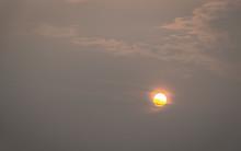 Red Sun On An Orange Smoky Sky.