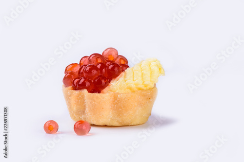 Tartlet with red caviar and butter isolated on white background