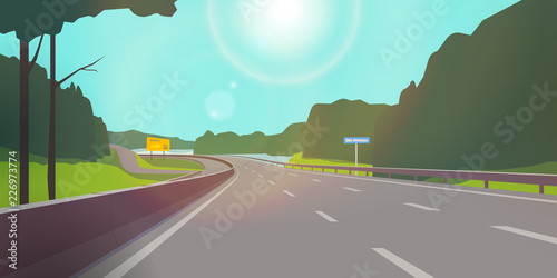 The road against nature. Clear sunny day. The highway passes through the forest and meadows. - fototapety na wymiar