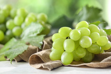 Ripe Juicy Grapes On Wooden Table, Closeup