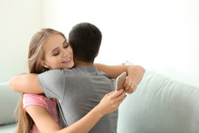Young Woman Texting Lover Whil...