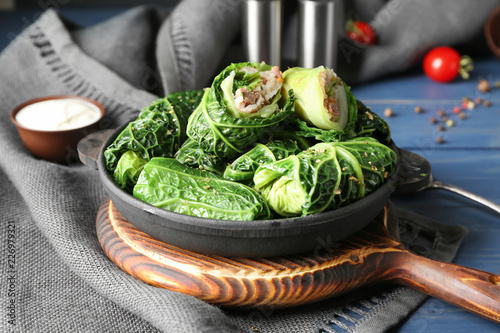 Obraz Pan with stuffed cabbage leaves on wooden board - fototapety do salonu