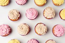 Delicious Cupcakes On White Ba...