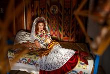 Beautiful Girl In A Hut In National Slavic Costume