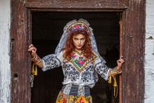 Beautiful Girl In A Hut In National Slavic Costume