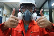 Multi-purpose Respirator Half Mask For Toxic Gas Protection.The Man Prepare To Wear Multi-purpose Half Mask For Measure Toxic Gas.