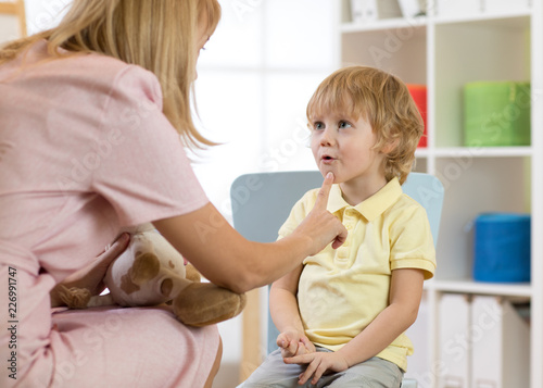 Cute little boy at speech therapist office