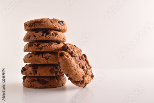 Tuinposter Koekjes Stack of cookies with chocolate on table and white background