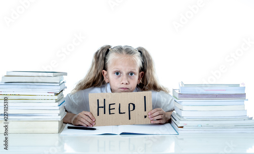 Photographie Stressed school girl feeling frustrated and unable to concentrate in her studies